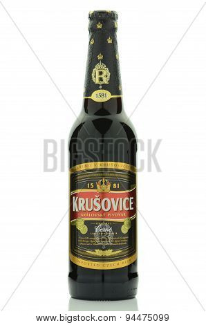 Krusovice dark premium beer isolated on white background.