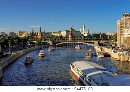 Moscow, Russia - JUNE 12, 2015 - Summer ships traffic on Moscow river near the Kremlin