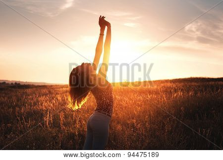 Free Happy Woman Raising Arms At Sunset In The Field