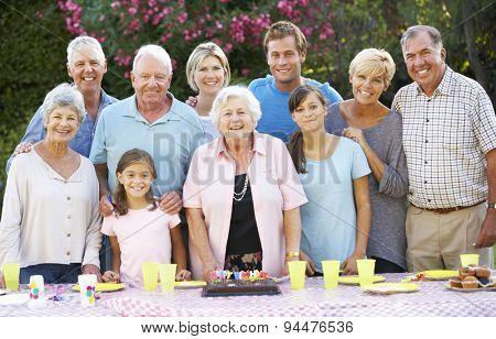 Large Family Group Celebrating Birthday Outdoors