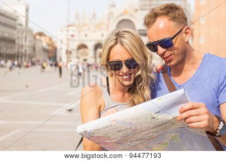 Tourists couple looking at city map
