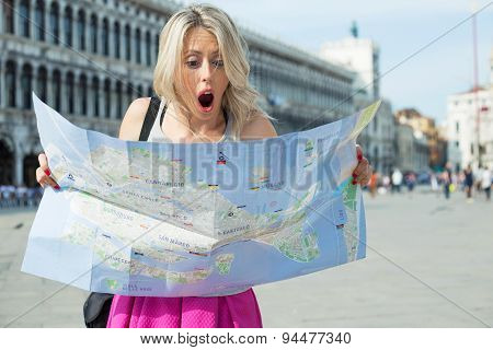 Tourist looking at city map with shocked expression