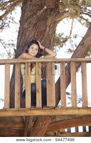 Teenage Girl In Treehouse