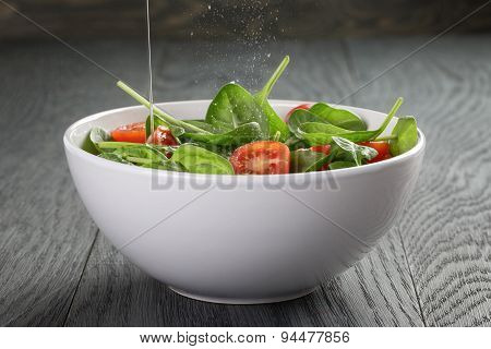 fresh summer organic salad with tomatoes cucumbers and spinach