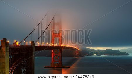 Foggy Golden Gate Bridge at sunset, San Francisco, California