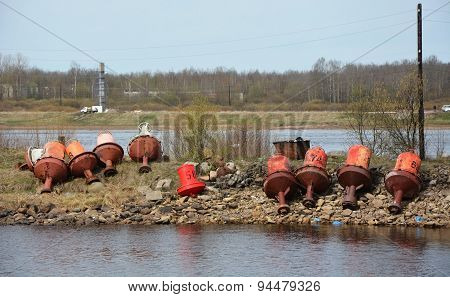 Rustic, Abandoned Buoys On The Sea Shore