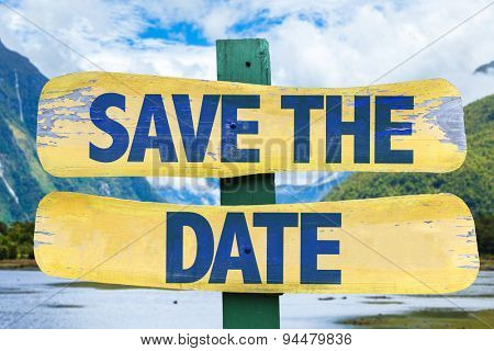 Save The Date sign with mountains background