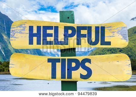 Helpful Tips sign with mountains background