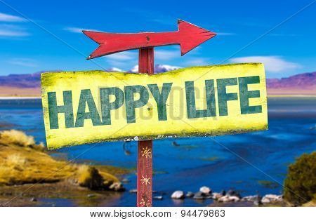 Happy Life sign with landscape background