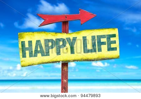Happy Life sign with beach background