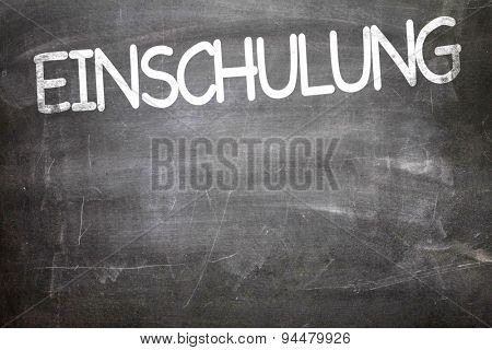 School Enrollment (in German) written on a chalkboard