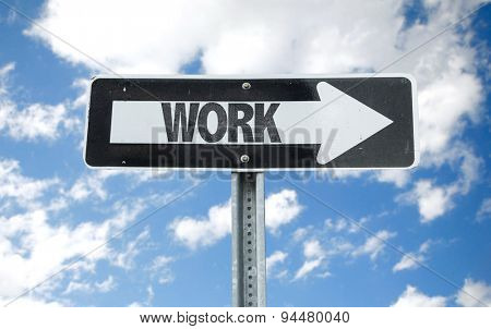 Work direction sign with sky background