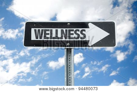 Wellness direction sign with sky background