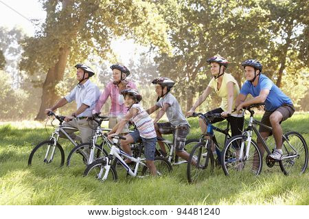 Three Generation Family On Cycle Ride In Countryside
