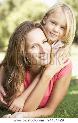 Mother And Daughter Relaxing Together In Park