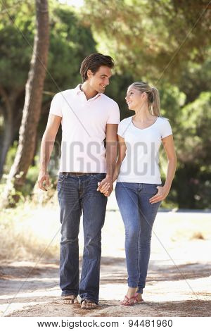 Young Couple On Romantic Walk In Countryside