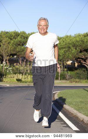 Senior Man Running On Road