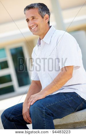 Portrait man sitting outdoors