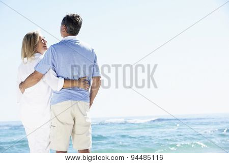 Senior Couple Relaxing By Ocean