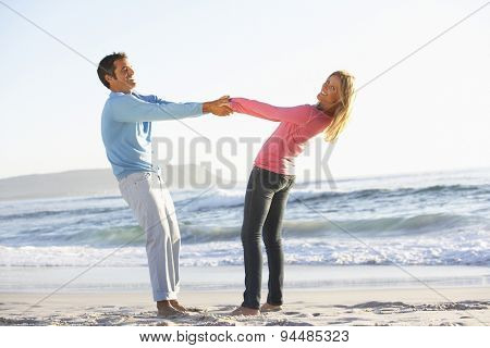 Young Couple Having Fun On Sandy Beach