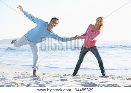 Young Couple Having Fun On Sandy Beach On Holiday