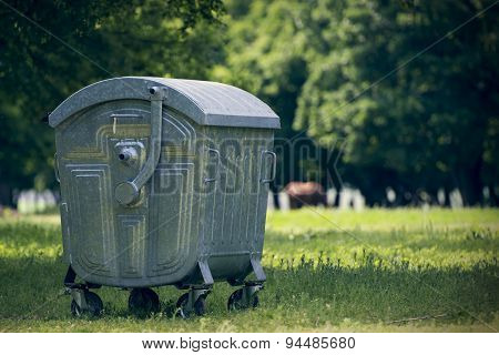 Green Dumpster In Forest For Tourists