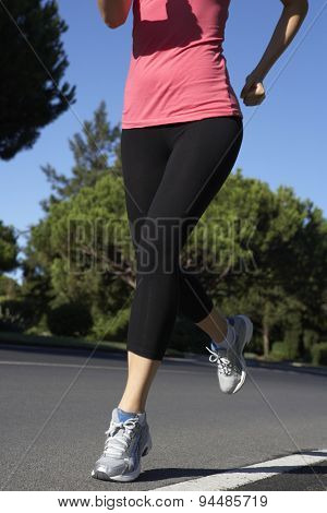 Close Up Of Woman Running On Road