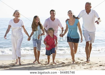 Three Generation Family Having Fun On Beach