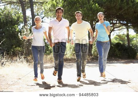 Group Of Young Friends On Walk In Countryside