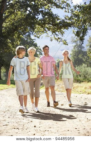 Middle Aged Family Walking Through Countryside