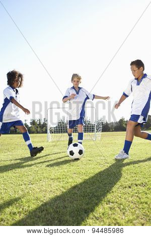 Group Of Boys Playing Football