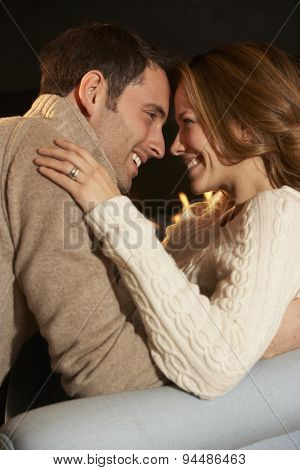 Romantic portrait couple in front of fire