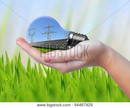 Hand holding eco light bulb. Green energy concept.
