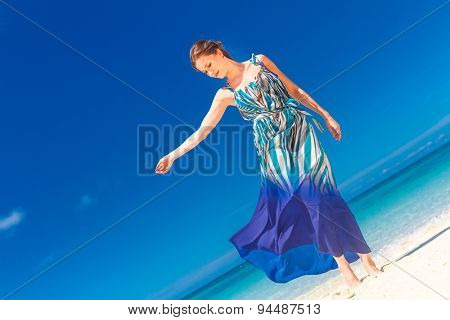 young beautiful woman walking by tropical sand beach, summer vacation