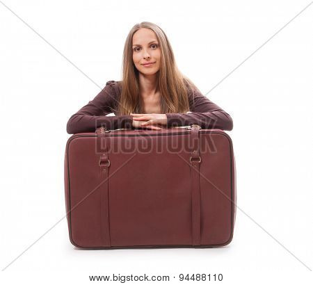 Woman sitting near a suitcase, isolated on white background