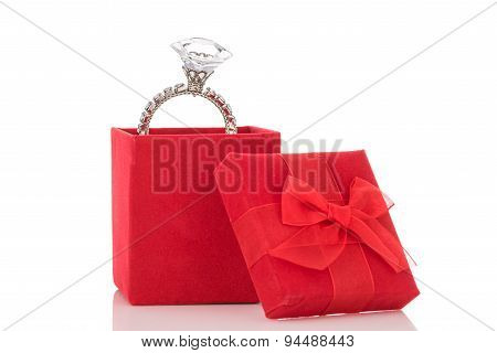 Giant Diamond Ring In Red Box Isolated On White Background