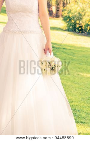 Bride Holds In Hand A Wedding Bouquet Of Flowers In A Garden, Vintage Style