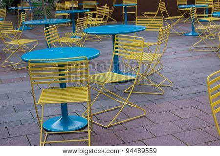 Yellow Chairs And Blue Tables