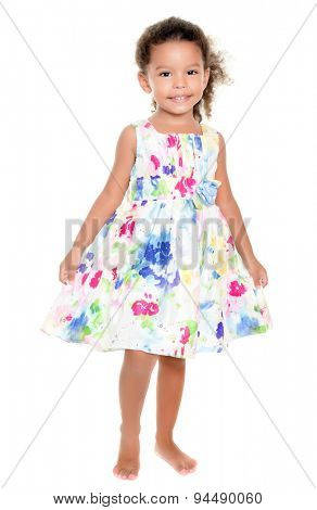 Cute small hispanic girl wearing a flowers summer dress isolated on white