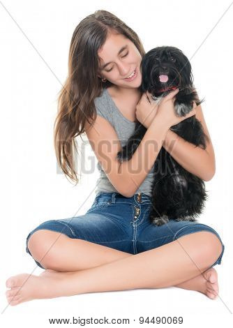 Pretty teenage girl hugging her pet dog isolated on white