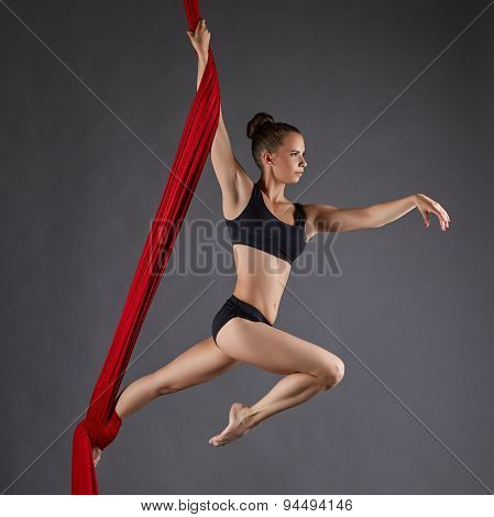 Image of beautiful dance performer on aerial silks
