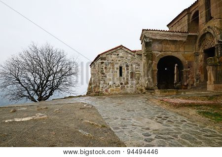 Ancient temple-monastery Jvari (Cross) on rainy day. Mtskheta, Georgia