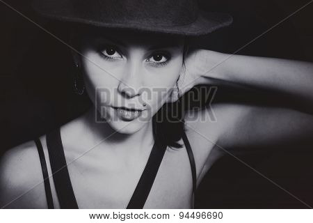 Portrait Of A Young Asian Woman In A Hat