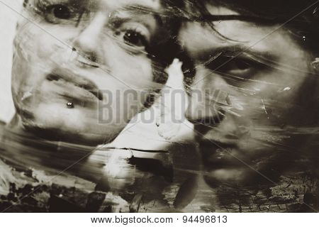 Man's And Woman's Faces At A Dirty Muddy Glass