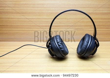 Headphones On Wood Background