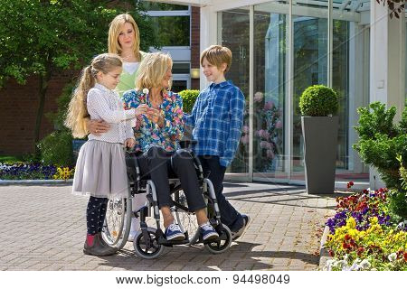 Grandchildren Visiting Grandmother In Wheelchair