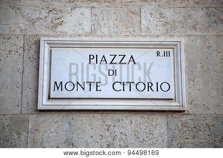 Street Plate Of Piazza Di Monte Citorio In Rome, Italy