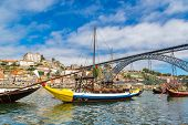 picture of old boat  - Porto and old traditional boats with wine barrels in Portugal in a summer day - JPG