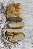 stock photo of whole-grain  - whole grain bread with pecans on a light wooden background - JPG
