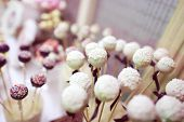stock photo of cake pop  - Capture of Delicious cake pops on table - JPG